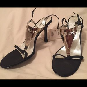 Black Bebe shoes with silver accents